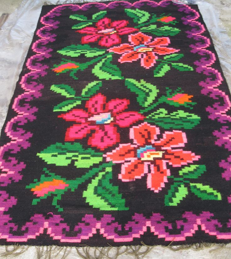 Beautiful antique traditional Romanian woven wool carpet / rug with floral pattern. Hand woven in Northern Transylvania / Maramures county 50 - 70 years ago Available at www.greatblouses.com