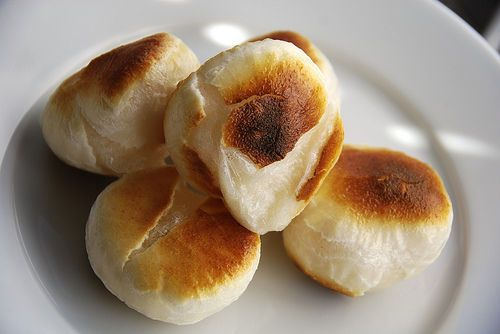 Yaki-mochi (toasted rice cake), eaten dipped in soy sauce. Mochi is a Japanese rice cake made of sticky (glutinous) rice  pounded into paste and molded into the desired shape.