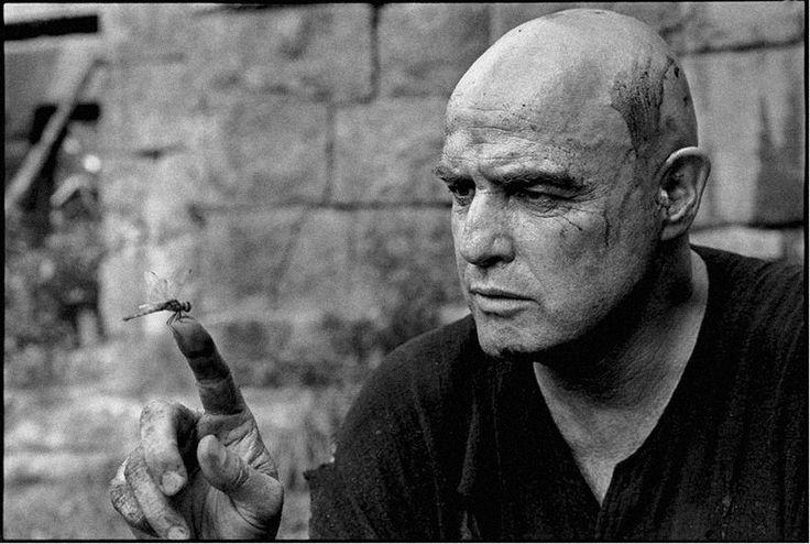 "Mary Ellen Mark. Marlon Brando fascinated by a dragonfly, ""Apocalypse Now,"" Philippines, 1976    http://semioticapocalypse.tumblr.com"