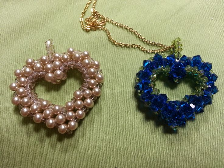 Stitch a pearl or crystal heart.