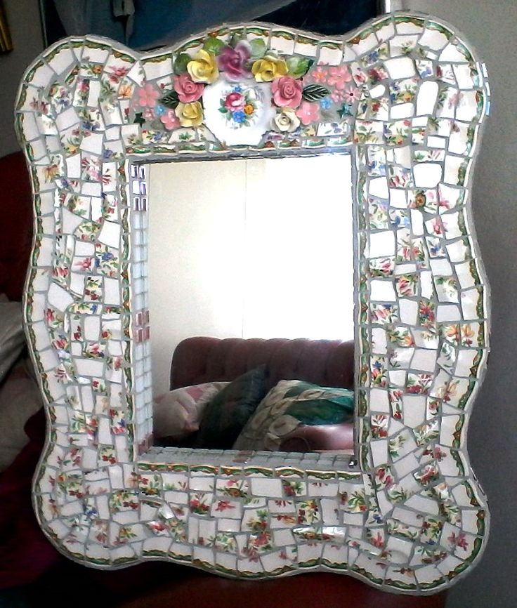 The china plates I broke to make this pique assiette mirror were very ugly but the frame came out quite nice. Mosaic mirrors made from broken china are the best. SOLD