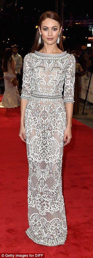 Silver siren: Bond Girl, Olga Kurylenko, drew attention thanks to her intricate semi-sheer maxi dress #Ralph&Russo Fall 2014 Couture
