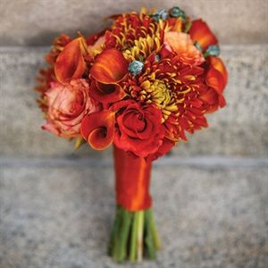 Lydia's bridesmaids (all nine of them!) carried vibrant yellow, orange and red bunches of chrysan