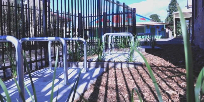 Showcase: Park bikes at your school. Here's a bike parking area at a primary school we did with the local community. These bike racks are specifically for  children.