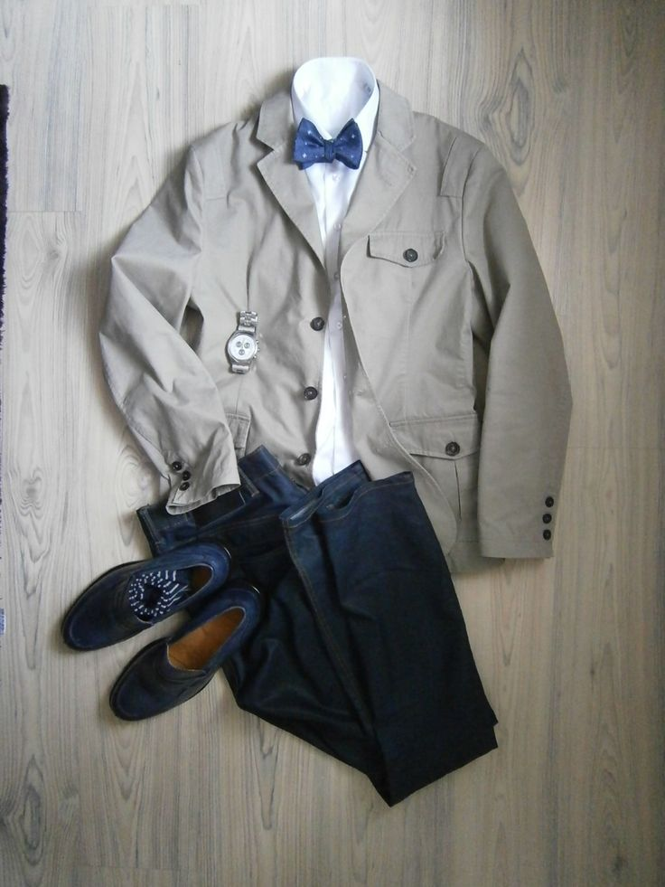 putty grey travel jacket / blue jeans / white long arm shirt / blue dotted bowtie / blue loafers / white blue striped socks / white chronographs