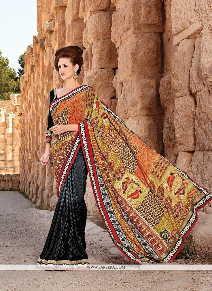 This delightful diva accoutre features unique styling and unusual material. Women magnificence is magnified tenfold in this alluring multi colour georgette and jacquard printed saree. The ethnic digit...