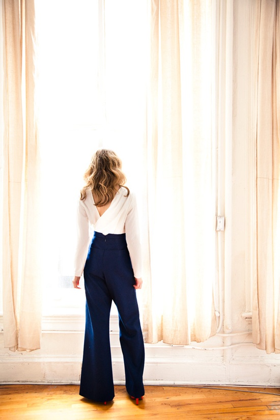 drape back blouse and blue pants