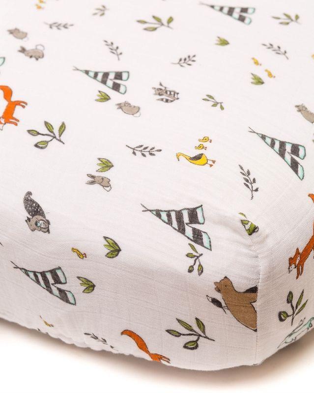 Little Unicorn Muslin Crib Sheet in Forest Friends - a woodland nursery essential!