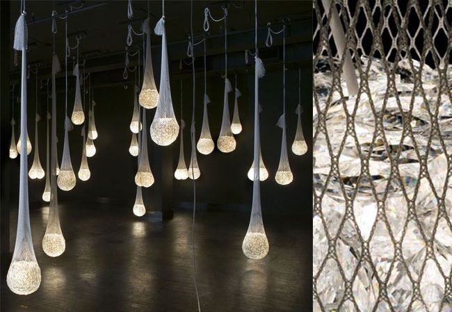 """the traditional chandelier with brilliant simplicity – instead of the branching structure and pendant crystals of traditional chandelier, this """"people's chandelier"""" is just a bag full of crystals. A single light source buried in the mass intensifies the optical effects of the cut glass beyond that of a typical chandelier."""