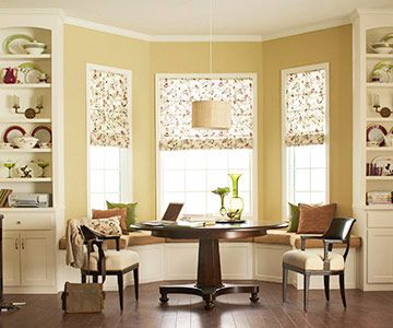 Our dinning room has the same bay window! I want to build a bench. The book cases would be wonderful with it too!