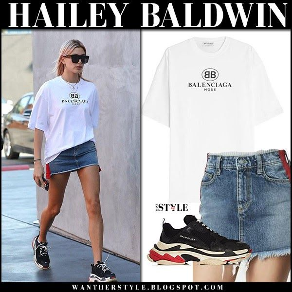 Hailey Baldwin in white logo tee, denim mini skirt and black sneakers in West Hollywood on January 11 2018
