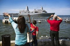 Families wave to their loved ones aboard USS Mesa Verde as the ship departs Naval Station Norfolk.