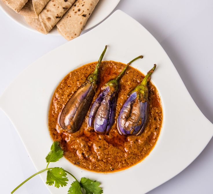 Make this delicious Andhra style stuffed brinjal commonly known as Gutti Vankaya curry. Brinjal is simmered in a tangy tamarind extract and then stuffed with aromatic roasted spices and the final tadka just makes the curry delicious. Serve it with roti or rice roti or biryani. Recipe by Uma. In association with Preethi Kitchen Appliances. #MothersDayContest. --> http://ift.tt/25o6qd3 #Vegetarian #Recipes