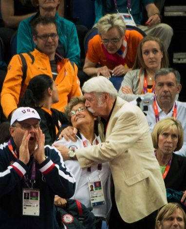Bela Karolyi kisses his wife, USA gymnastics team coordinator Marta Karolyi, in the crowd after an appeal awarded gymnast Aly Raisman an additional .10 points in difficulty giving her the bronze medal in the event during the women's gymnastics apparatus finals at the 2012 London Olympics on Tuesday, Aug. 7, 2012.