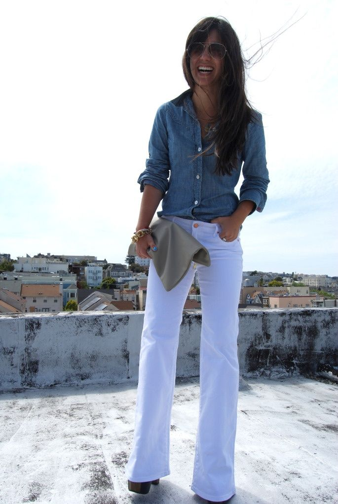 white jeans and chambray top with a tan clutch
