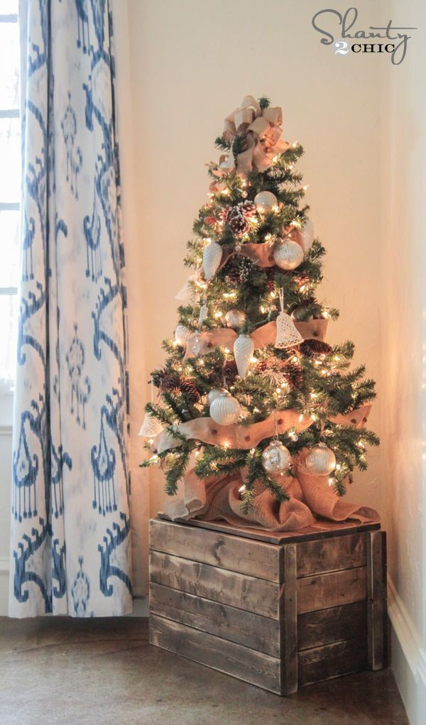We love this idea of using a wooden crate to hold your Christmas tree
