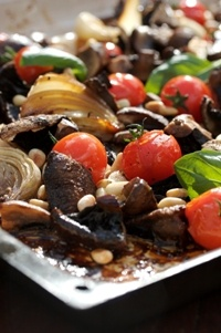 Tomatoes, onions & mushrooms on a baking tray  from Food from the heart. Courtesy of Lapa Publishers, photo by Adriaan Vorster