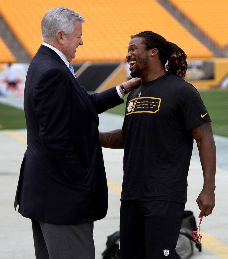 Carolina Panthers owner Jerry Richardson, left, and Pittsburgh Steelers running back DeAngelo Williams, right, greet one another prior to the team's preseason game on Thursday, September 3, 2015 at Heinz Field in Pittsburgh, PA. Williams formerly played for the Carolina Panthers.