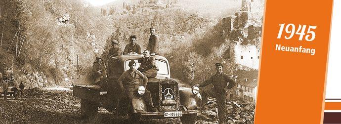 1945: Ein zum Lkw umgebauter Bus in einem Steinwerk im Raum Kempenich