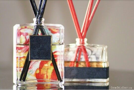 I love this idea of using old perfume or cologne bottles to make reed defusers! Just add 1/4 cup of baby oil, water, or coconut oil, 30 drops of your favorite essential oil, and 4 or 5 reed sticks. To add an extra pop, modge podge some fun scrapbook paper to the back side of the glass. So simple and so fun!