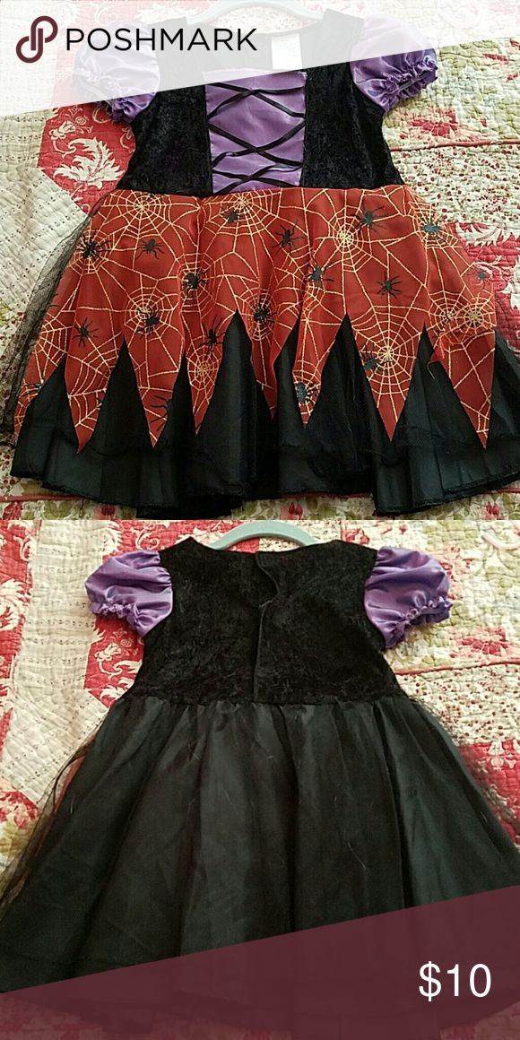 Toddler Witch Costume A cute yet spooky witch costume for the little spookster in your world! It has a velcro closure and cute tulle around the bottom. It is 100% polyester material. No tears, stains or discoloration. Costumes Halloween