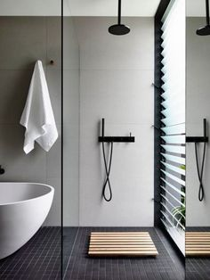 Love this open shower in this chic bathroom.