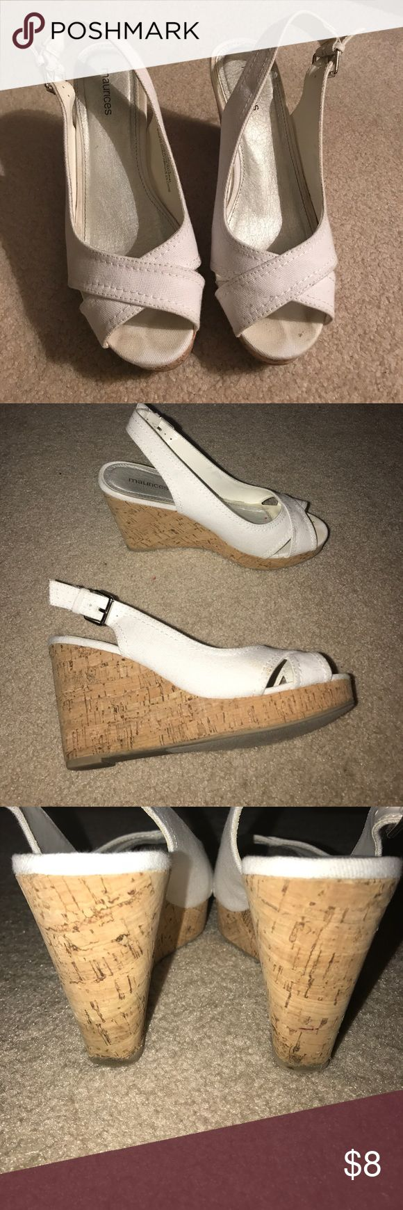 White wedges Maurice's white wedges size 8. The cork on the wedge has some wrinkles in them, they came from the store that way and it's hardly noticeable. There is one spot on the side of one of the shoes that has a small light spot (see pic). These have only been worn a couple time and are still in good shape! Maurices Shoes Wedges