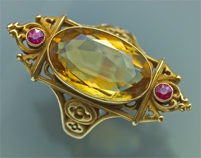 Wedding ring 1400's.  Beyond vintage.  Gold with large yellow gem and smaller magenta gems.  Amazing!
