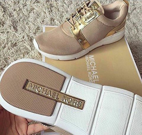 MK gold trainers
