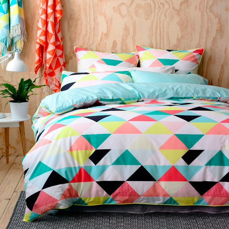 In this season's hottest trend, geometric designs make up the Flagstaff quilt cover from Home Republic. Printed on pure cotton base cloth and contrast aqua triangle reverse allows for funky styling options. Bright yellow trim and coordinating european pillowcases complete the stylish look.