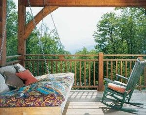 """Ann designed the swing, which can be used as a bed for guests, and Jean made it. """"I go out and read on it on many afternoons, and some of our braver and younger guests often begin their nights out there until their imaginations or the night noises bring them in,"""" notes Ann."""
