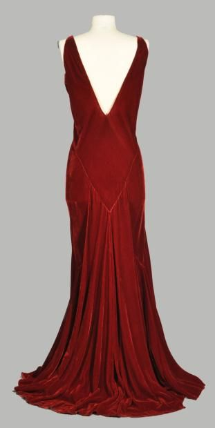 circa 1933 velvet evening gown with Art Deco silhouette, train from deep V seam in back, in ruby ​​red velvet