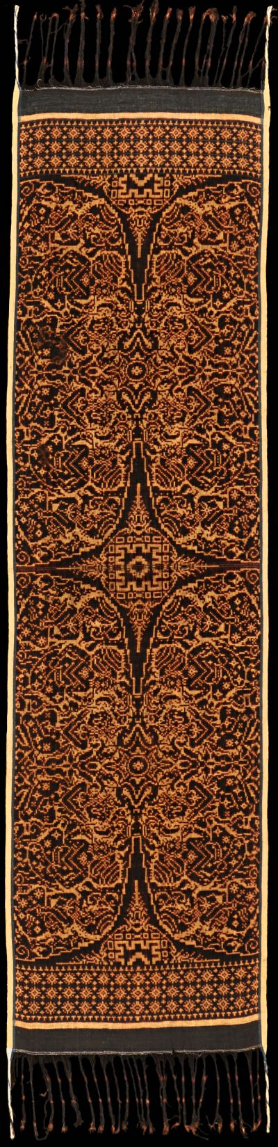 Ikat from Tenganan, Bali Group, Indonesia. Geringsing wayang kebo. Field divided into semicircles by four-pointed stars. In the semicircles are two groups of three people, probably representing an audience between a priest, his wife and a devotee. The borders consist of three rows of star flowers. Black on ecru. Cloth has a warm undertone, probably due to a bath of ayar kuning.