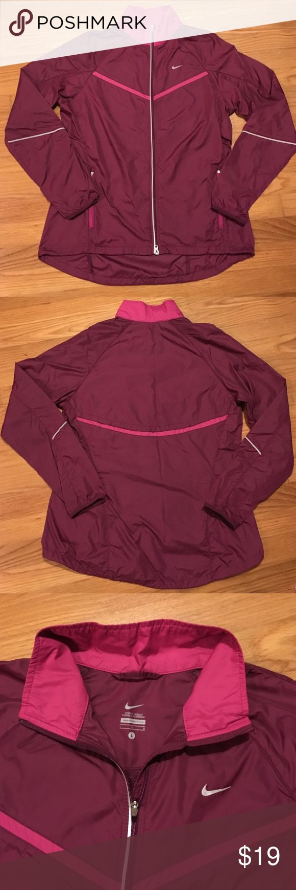 """Nike windbreaker running jacket. Nike windbreaker running jacket. Like new. Size large. Nike running jackets are made longer in the back than front. Shoulder to hem front 25.5"""". Shoulder to hem back 28.5"""". Material is just like the Nike tempo running shorts. Thin lightweight unlined  jacket.  Perfect for cool windy days. Zippered pockets and front with reflective trim on front and back of jacket and sleeves. Maroon color with pink trim. Nike Jackets & Coats"""