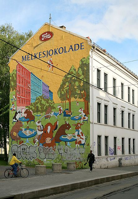Schous plass ~ building ad for chocolate, Oslo, Norway.  Photo:  Helena Normark, via Flickr
