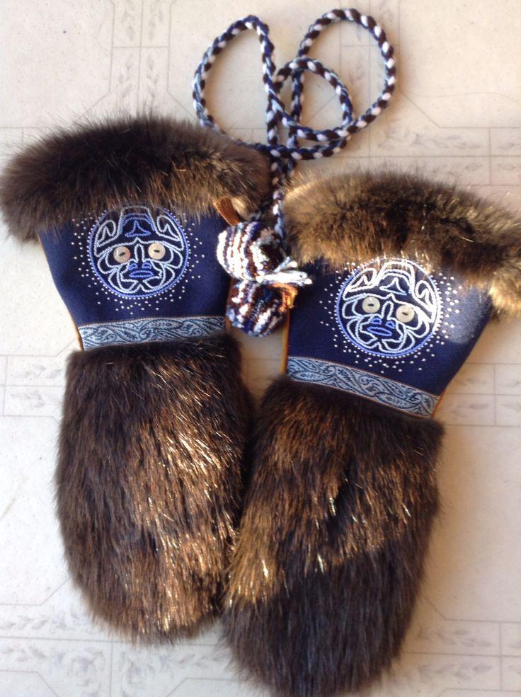 Men's mitts- Czech beading on navy blue Melton, beaver fur, commercial tanned moose hide, vintage ribbon trim, and Pom-poms & 4 strand braid string made with Yarn Carmen Dennis