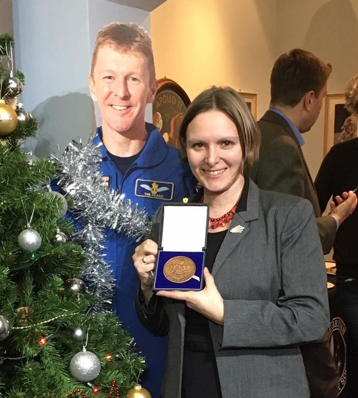 Vix Soutgate having received the British Interplanetary Society's Patrick Moore medal, 7 December 2016, for outstanding services to the BIS, including her hard work for STEM Outreach through World Space Week UK and her creation CASSiE (the Cosmic Ambassador for Space Science and Engineering), the Cosmic Hedgehog.