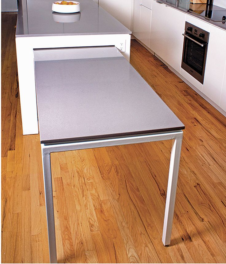 This kitchen island with a pull-out table was actually my client's idea. He and his wife sometimes entertain large groups of guests, and they wanted to easily seat more people …