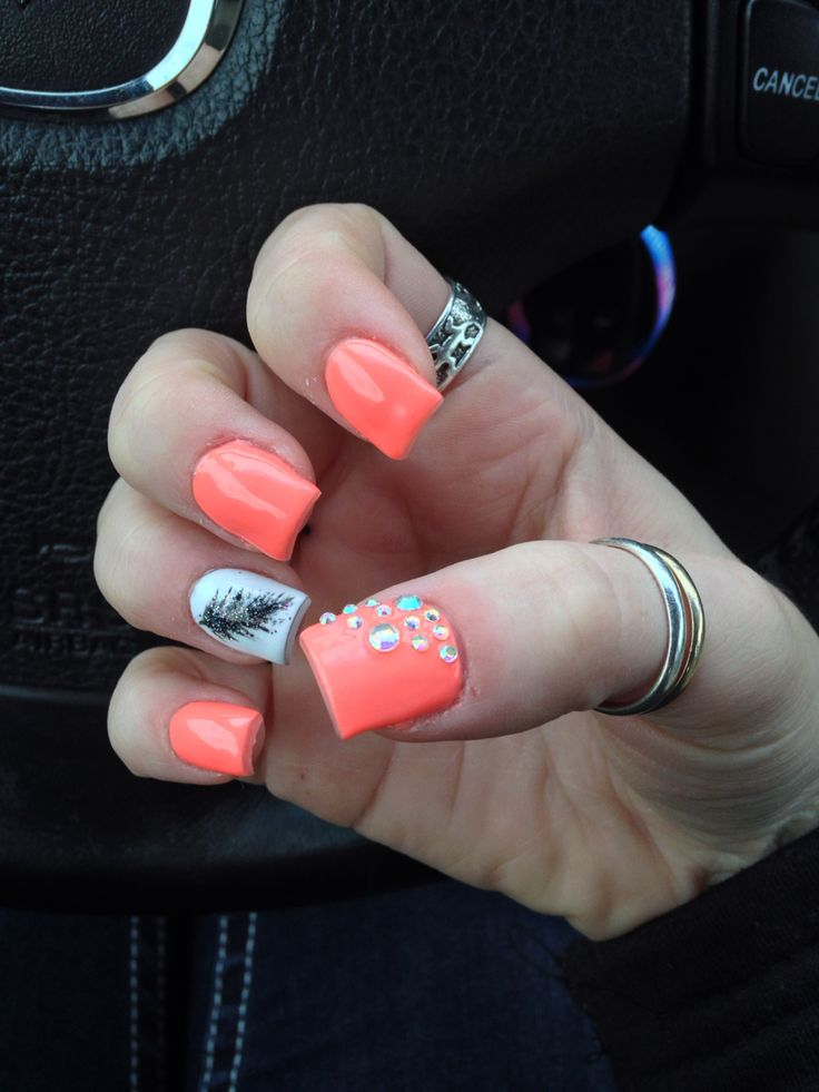 Coral nails with white accent nail, & glitter feather.