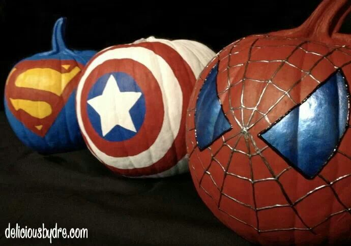 Painted Pumpkins = Awesome maybe we could put a couple of these on the front porch with another one with a cut out cross/super hero emblem?