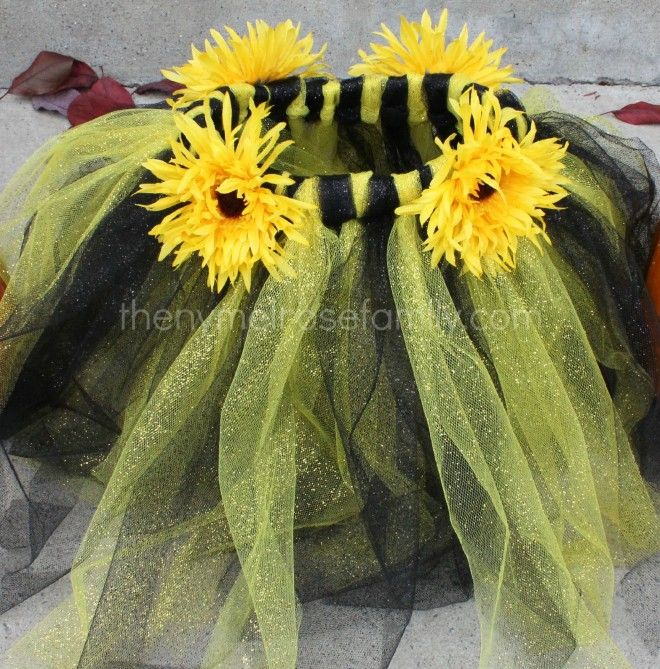 A no sew gold and black sparkle tutu with sunflowers glued on for a bumble bee costume.