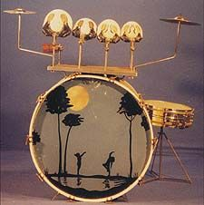 Vintage drum kit consisting of two cymbals, wood blocks, snare drum and a bass drum with jazz age art deco style motif of two women dancing next to a moonlit lake - from the collection of Sir Alan Buckley