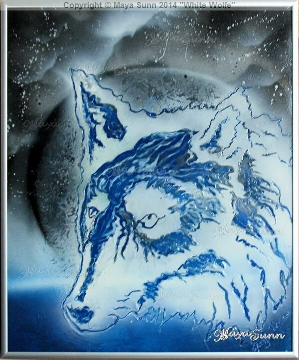 White wolf under the moon