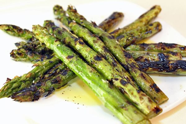 Asparagi alla Griglia - Grilled asparagus served with olive oil, garlic and shaved parmigiano. www.agiobistro.com