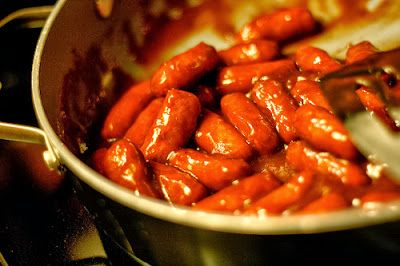 BBQ Cocktail Wieners ~ a definite man-pleaser! his recipe calls for cranberry sauce instead of the usual grape jelly, and coats the wieners well.