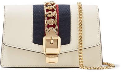 12973ddd647 Gucci - Sylvie Mini Chain-embellished Leather Shoulder Bag - Gucci   ShopStyle