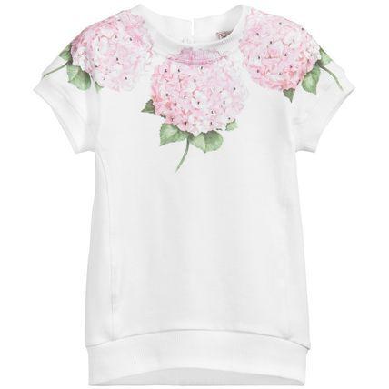 春夏2016【モナリザ】あじさい花柄☆半袖スウェット・ワンピ♪ 初夏を感じる美しいアジサイ・プリントが魅力のベビー・ワンピース♪  爽やかなホワイト生地に優しいピンク・フローラルが映える  ベビー服ながら大人っぽさも感じられるフェミニンな一着です。  スウェット素材&ゴム入り仕上げの裾でスポーティーなシルエットをフィーチャーしつつ  ネックラインのお花プリントにはキラキラ光るラインストーンを施した  クールでありながら女の子らしさを感じさせるデザインがオシャレ☆  上品なガーリー・カジュアルとしてデイリーにお使いいただけるこちらのアイテムは  春夏生まれのお子様へのご出産祝いとしても最適なベビー・ワンピです。