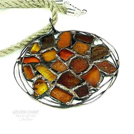 Baltic amber round pendant. ONE of a kind nice and classy