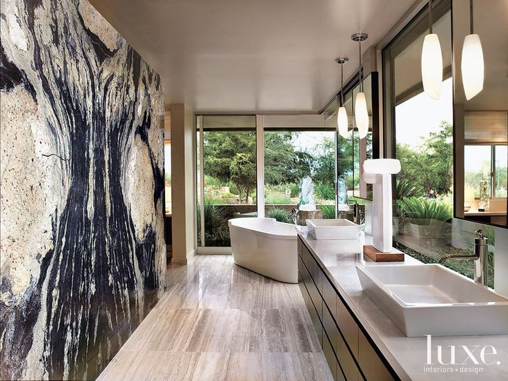 luxe 10 covet worthy bathroom granite a wall of granite wraps this master bathroom craftsmen skillfully mitered the slabs for the perfect rorschach