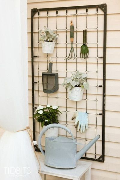 Have a crib bed spring on hand? Attach it to your wall to get your gardening supplies organized.